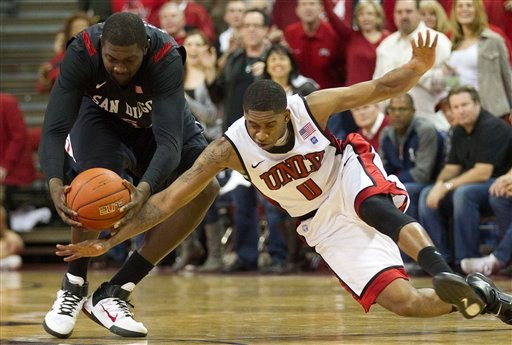 UNLV's Oscar Bellfield, right, dives for a loose ball against San Diego State's Brian Carlwell.