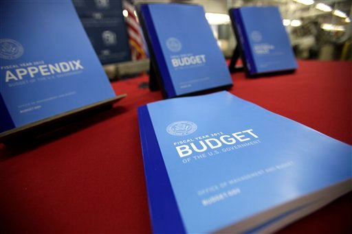 In this photo taken Feb. 10, 2011, the 2012 budget is on display at the U.S. Government Printing Office at Washington. (AP Photo/Jacquelyn Martin)