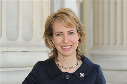 In this March, 2010 file photo provided by the office of Rep. Gabrielle Giffords, D-Ariz., Giffords poses for a photo. (AP Photo/Office of Rep. Gabrielle Giffords, File)