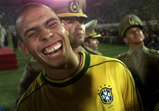 In this photo taken July 18, 1999, Brazil's Ronaldo laughs after his team defeated Uruguay 3-0 to clinch the America's Cup at Defensores del Chaco Stadium in Asuncion, Paraguay. (AP Photo/Dario Lopez-Mills)