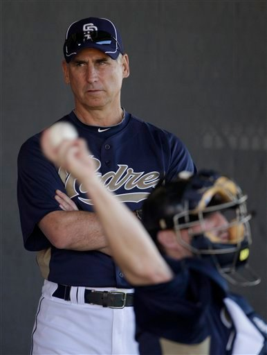 San Diego Padres manager Bud Black, left, watches a pitchers warmup during baseball spring training, Monday, Feb. 14, 2011, in Peoria, Ariz. (AP Photo/Charlie Riedel)