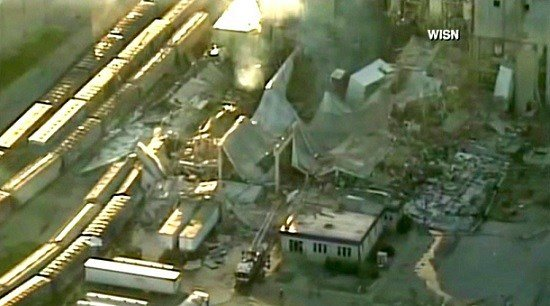 WISN-TV, the rubble of a corn mill plant following an explosion is seen.