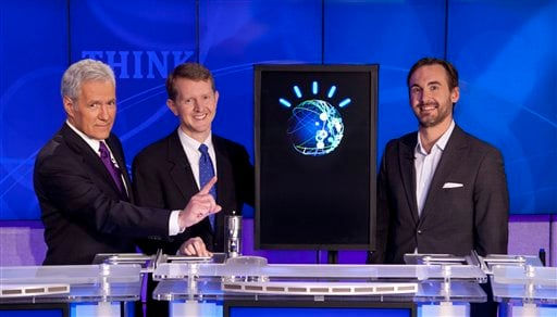 In this undated publicity image released by Jeopardy Productions, Inc., host Alex Trebek, left, poses with contestants Ken Jennings, center, and Brad Rutter and a computer named Watson in Yorktown Heights, N.Y. On Monday, Feb. 14, 2011.