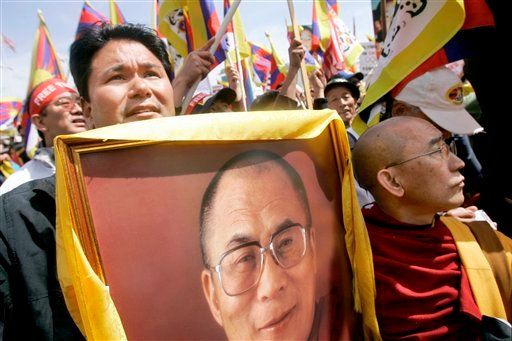 April 8, 2008 file photo shows Jigme Norbu, left, nephew of the Dalai Lama, standing next to Thupten Donyo, right, holding up a photo of the Dalai Lama, as they rally with Tibetans and supporters at City Hall in San Francisco. (AP Photo/Jeff Chiu,File)