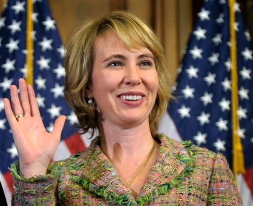 In this Jan. 5, 2011 file photo, Rep. Gabrielle Giffords, D-Ariz., takes part in a reenactment of her swearing-in, on Capitol Hill in Washington. (AP Photo/Susan Walsh, File)
