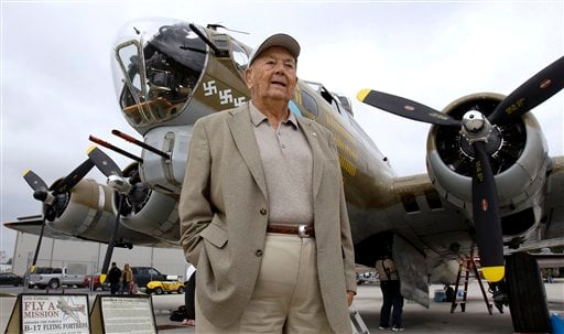 In this photo taken Feb. 11, 2011, 92-year-old Norbert Swierz, of Palm Harbor, Fla., poses in front of a B-17 bomber Friday in Kissimmee, Fla. Swierz is flying for the first time in a B-17 since we was shot down over 60 years ago during World War II.
