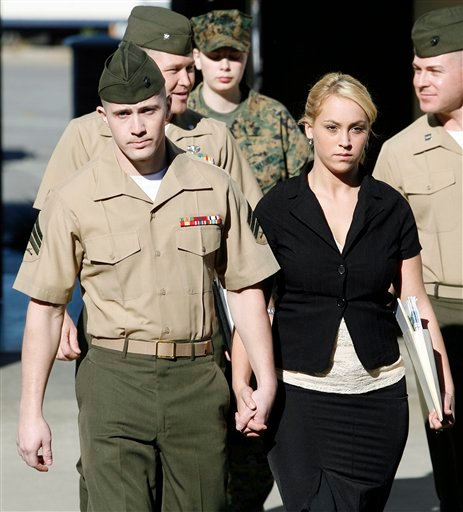 In this Thursday Dec.7, 2006 file photo, Marine Corps Sgt. Lawrence Hutchins, 22, of Plymouth, Mass., left, leaves his arraignment hearing with his wife Reyna Hutchins at Camp Pendleton Marine Corps Base, Calif.