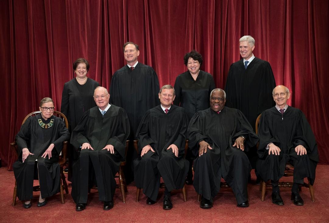 The justices of the U.S. Supreme Court gather for an official group portrait to include new Associate Justice Neil Gorsuch, top row, far right. (AP Photo/J. Scott Applewhite)