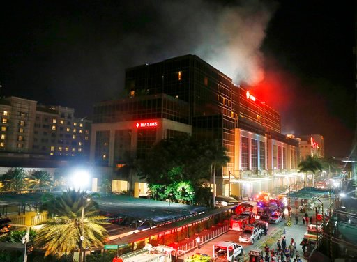 Smoke rises from the Resorts World Manila complex early Friday, June 2, 2017 in suburban Pasay city southeast of Manila, Philippines. (AP Photo/Bullit Marquez)