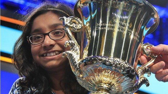 Ananya Vinay from Fresno, Calif., holds the trophy after being declared the winner of the 90th Scripps National Spelling Bee, in Oxon Hill, Md.