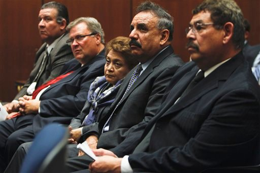 From left, Luis Artiga, George Cole, Teresa Jacobo, Oscar Hernandez and George Mirabal listen during a preliminary hearing on Monday, Feb. 7, 2011 in Los Angeles.