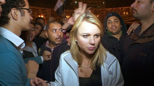"""In this Feb. 11, 2011 photo released by CBS, """"60 Minutes"""" correspondent Lara Logan is shown covering the reaction in in Cairo's Tahrir Square the day Egyptian President Hosni Mubarak stepped down."""