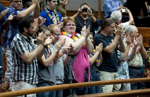 Supports of the Hawaii Civil Unions Bill applaud, celebrating the Hawaii Senate's vote 18-5 to approve the Civil Unions bill at the Hawaii State Capitol Feb. 16, 2011 in Honolulu. (AP Photo/Eugene Tanner)