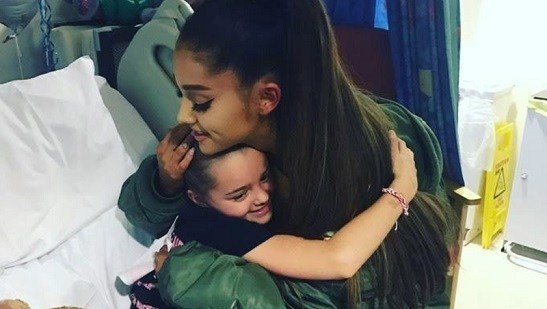 Manchester Evening News, victim of the Manchester concert blast Lily Harrison hugs singer Ariana Grande during her visit .