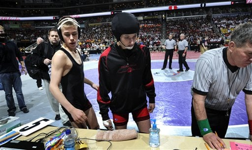 Cedar Falls' Casey Herkleman, right, and her opponent Joel Northrup, of Linn-Mar of Marion, stand at the scorers table prior to their first-round match at the Iowa State Wrestling tournament Feb. 17, 2011 in Des Moines, Iowa. (AP Photo/Steve Pope)