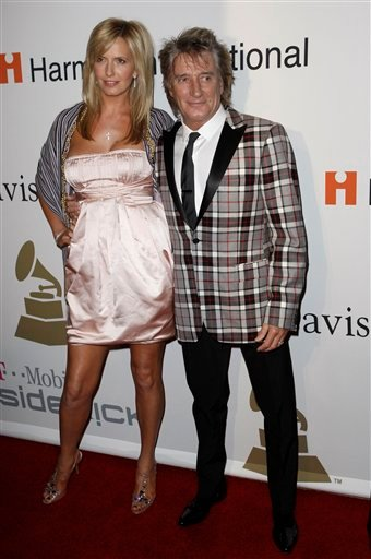 This is a Saturday, Feb. 7, 2009. file photo of Rod Stewart, right, and Penny Lancaster as they arrive at the Clive Davis pre-Grammy party in Beverly Hills, Calif.