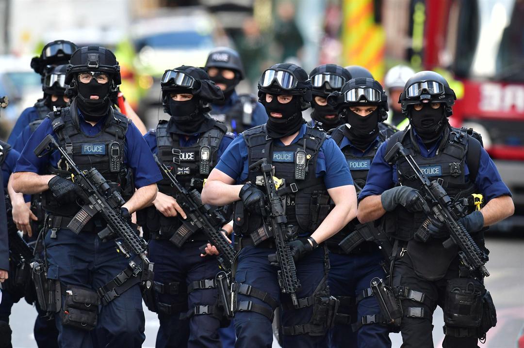 Armed police on St Thomas Street, London, Sunday June 4, 2017, near the scene of Saturday night's terrorist incident.  (Dominic Lipinski/PA via AP)