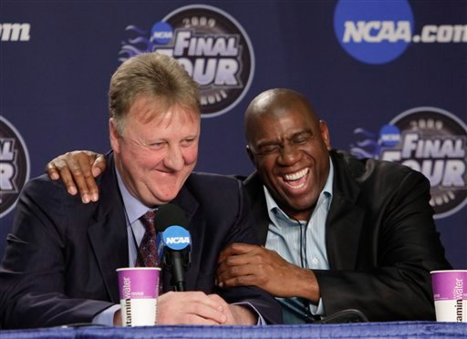 "In this April 6, 2009 file photo, former NBA players Earvin ""Magic"" Johnson, right, and Larry Bird laugh at a news conference"