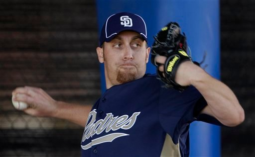 San Diego Padres pitcher Aaron Harang throws during baseball spring training Monday, Feb. 14, 2011, in Peoria, Ariz.