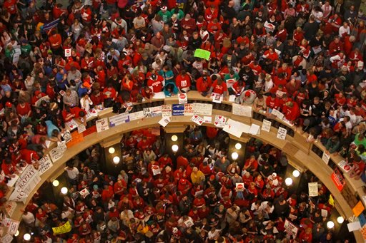 Protestors of Wisconsin Gov. Scott Walker's bill to eliminate collective bargaining rights for many state workers pack the rotunda at the State Capitol in Madison, Wis., Thursday, Feb. 17, 2011. (AP Photo/Andy Manis)