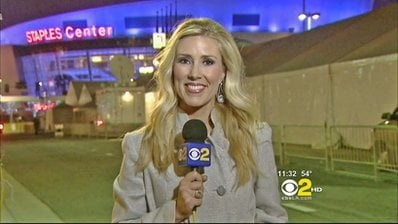FILE - In this Sunday, Feb .13, 2011 undated handout file photo provided by KCBS in Los Angeles, veteran TV journalist Serene Branson reports on the Grammy awards show outside the Staples Center in Los Angeles.