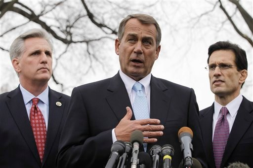 In this Feb. 9, 2011, file photo House Speaker John Boehner of Ohio, center, with House Majority Leader Eric Cantor of Va., right, and House Majority Whip Kevin McCarthy of Calif., speaks to reporters. (AP Photo/Charles Dharapak, File)