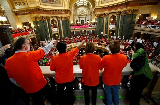 Democratic Wisconsin Assembly members cheer on the fourth day of large scale protests at the State Capitol in Madison, Wis., Friday, Feb. 18, 2011. (AP Photo/Andy Manis)