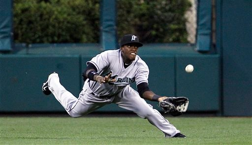 Cameron Maybin will roam the spacious confines of Petco Park for years to come. (AP)