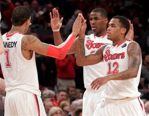 St. John's Dwight Hardy (12) high-fives teammate D.J. Kennedy during the second half of an NCAA college basketball game  (AP)