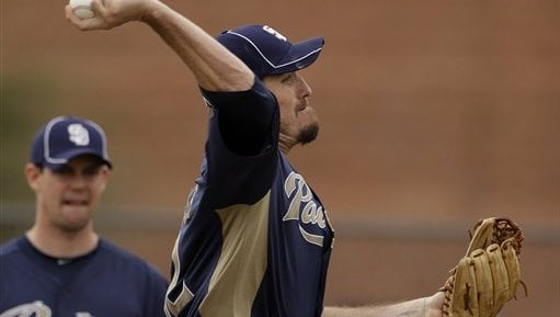 San Diego Padres pitcher Chad Qualls throws during baseball spring training Friday, Feb. 18, 2011, in Peoria, Ariz. (AP Photo/Charlie Riedel)