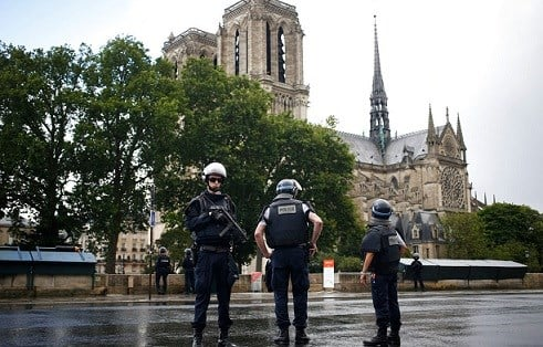 Police officers seal off the access to Notre Dame cathedral in Paris, France, Tuesday, June 6, 2017.