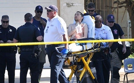 A shooting victim is taken away from a house, Tuesday, June 6, 2017, in Fresno, Calif.