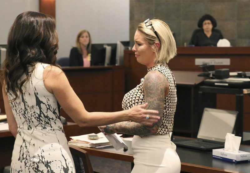 Christine Mackinday, right, ex-girlfriend of former mixed martial arts fighter Jonathan Koppenhaver, aka War Machine, comforted by prosecutor Jacqueline Bluth after delivering her victim-impact statement at the Regional Justice Center.