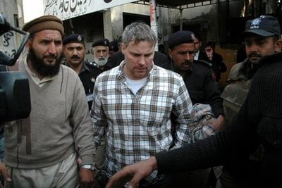 FILE - In this Jan. 28, 2011 file photo, Pakistani security officials escort Raymond Allen Davis, a U.S., center, to a local court in Lahore, Pakistan.