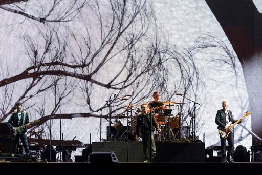 The Edge, Bono, Larry Mullen Jr. and Adam Clayton of U2 during the 30th anniversary of The Joshua Tree Tour at Soldier Field on June 4, 2017, in Chicago, Illinois (Sipa via AP Images)