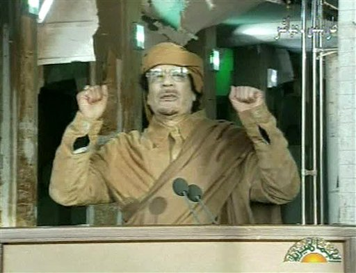This image broadcast on Libyan state television Tuesday, Feb. 22, 2011, shows Libyan leader Muammar Qaddafi as he addresses the nation in Tripoli, Libya. (AP Photo/Libya State Television via APTN)