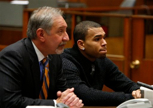 R&B singer Chris Brown appears with his attorney Mark Geragos for a progress report hearing in Los Angeles, Friday, Jan. 28, 2011.