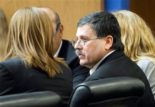 Faleh Hassan Almaleki sits with a attorney during his trail on Tuesday, Feb. 22, 2011 in Phoenix.