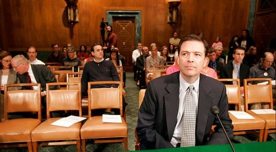 Then-former Deputy Attorney General James Comey waits to testify on Capitol Hill in Washington.