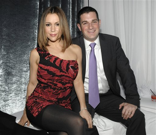 """FILE - In this Dec. 14, 2010 file photo, actress Alyssa Milano, left, and her husband, David Bugliari appear at the Blu-ray and DVD release party for the animated film """"Family Guy: It's a Trap"""" in Los Angeles. (AP Photo/Dan Steinberg, file)"""