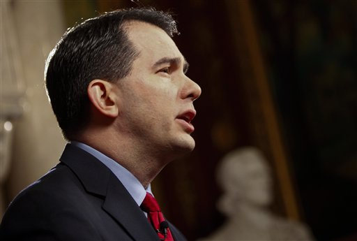 Wisconsin Gov. Scott Walker rehearses his fireside speech at the state Capitol in Madison, Wis.