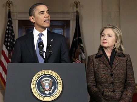 President Barack Obama, with Secretary of State Hillary Rodham Clinton at right, speaks about the situation in Libya in the Grand Foyer of the White House, Wednesday, Feb. 23, 2011, in Washington.