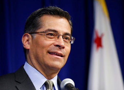 California Attorney General Xavier Becerra speaks at a news conference Wednesday, May 3, 2017, in Sacramento, Calif. Becerra said that he plans to target political nonprofit organizations that he said mislead donors and influence campaigns. (AP Photo/Rich