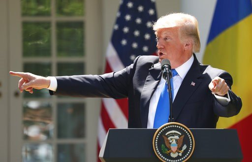 President Donald Trump, accompanied by Romanian President Klaus Werner Iohannis, speaks during a news conference in the Rose Garden at the White House, Friday, June 9, 2017, in Washington. (AP Photo/Andrew Harnik)