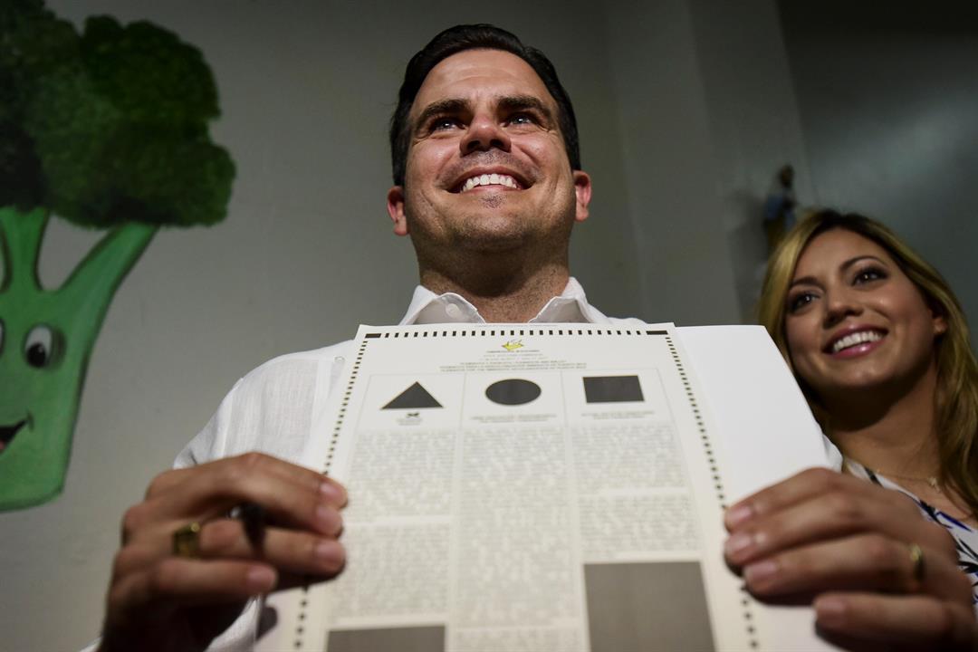 Gov. Ricardo Rossello shows his ballot at the San Jose Academy during the fifth referendum in San Juan, Puerto Rico, Sunday, June 11, 2017. (AP Photo/Carlos Giusti)