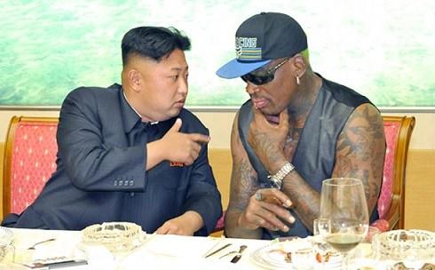 North Korean leader Kim Jong Un, left, talks with former NBA player Dennis Rodman during a dinner in North Korea.
