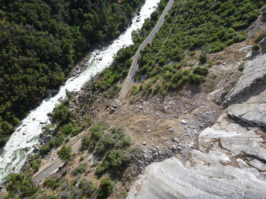 This Monday, June 12, 2017, photo provided by the National Park Service shows a rockslide that blocked one of the main roads into Yosemite National Park in California.  (NPS Photo via AP)