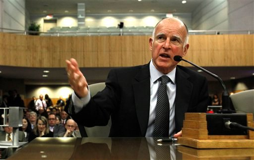 Gov. Jerry Brown responds to a question while appearing before the joint legislative budget conference committee at the Capitol in Sacramento, Calif., Thursday, Feb. 24, 2011. Brown, took questions from committee members about his proposed budget plan.
