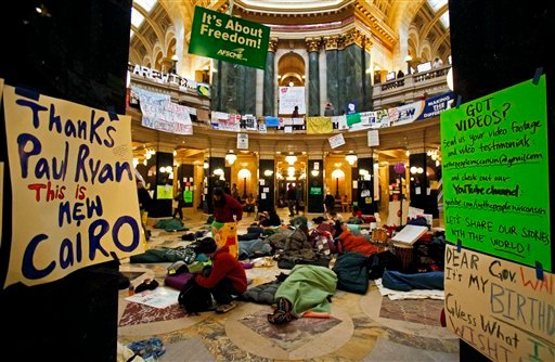 Opponents to the governor's bill to eliminate collective bargaining rights for many state workers sleep on the floor of the rotunda at the state Capitol in Madison, Wis., Thursday, Feb. 24, 2011, at the start of the tenth day of protests at the Capitol.