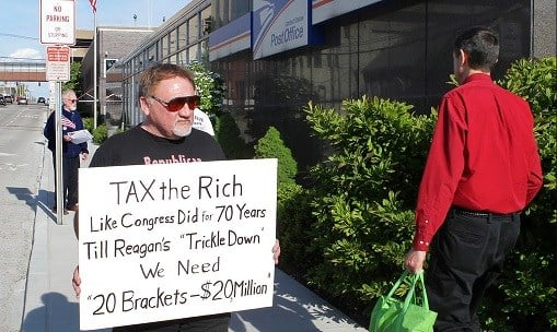 James Hodgkinson of Belleville protests outside of the United States Post Office in Downtown Belleville, Ill.